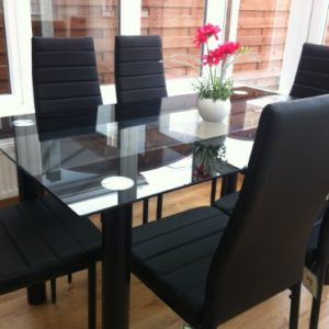STUNNING-GLASS-BLACK-DINING-TABLE-SET-AND-6-FAUX-LEATHER-CHAIRS-0